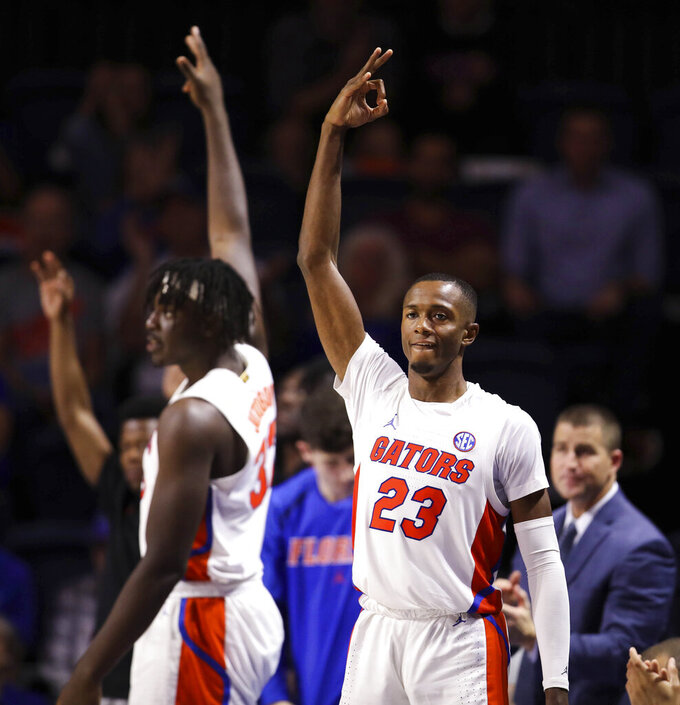 Florida guard Scottie Lewis (23) celebrates on the bench against North Florida during the second half of an NCAA college basketball game Tuesday, Nov. 5, 2019, in Gainesville, Fla. (AP Photo/Matt Stamey)
