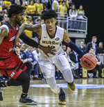 Murray State's Ja Morant gets past Jacksonville State's Ty Hudson during the semifinals of the Ohio Valley Conference Men's Basketball Championship at the Ford Center, Friday, March 9, 2019, in Evansville, IN. (Greg Eans/The Messenger-Inquirer via AP)