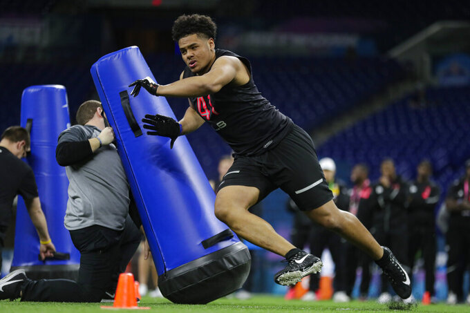 Boise State linebacker Curtis Weaver runs a drill at the NFL football scouting combine in Indianapolis, Saturday, Feb. 29, 2020. (AP Photo/Michael Conroy)