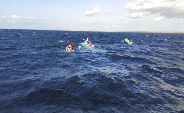 In this undated photo released by Indonesian National Search And Rescue Agency (BASARNAS), rescuers search for victims at the site of the sinking of a fishing boat in the waters of Pukuafu Strait, East Nusa Tenggara, Indonesia. The overloaded fishing boat carrying more than two dozens people capsized in eastern Indonesia, killing a number of passengers and leaving some others missing, an official said Monday, July 6, 2020. (BASARNAS via AP)