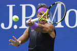 Rafael Nadal, of Spain, returns a shot to Daniil Medvedev, of Russia, during the men's singles final of the U.S. Open tennis championships Sunday, Sept. 8, 2019, in New York. (AP Photo/Charles Krupa)
