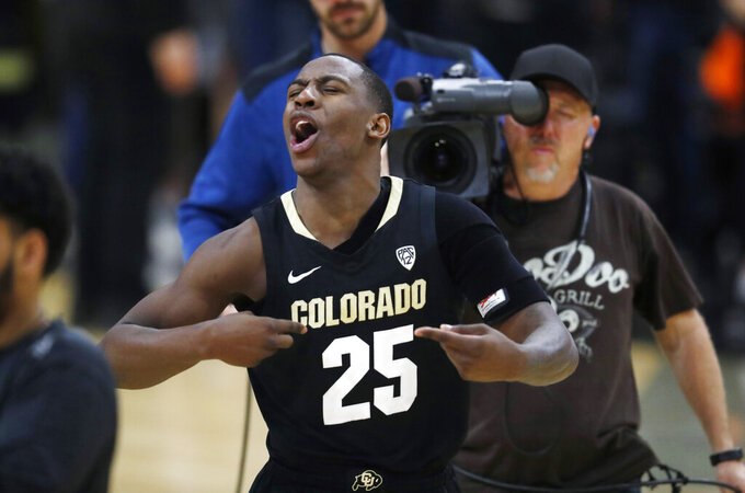"""FILE - In this Feb. 13, 2019, file photo, Colorado guard McKinley Wright IV celebrates as time runs out in the team's NCAA college basketball game against Arizona State in Boulder, Colo. The Buffs were voted second in the preseason Pac-12 Conference poll. That's rare territory for a team searching for its first NCAA appearance since 2015-16. Then again, they do return their six top scorers.  """"The bar is high for us of course,"""" said Wright, who along with Tyler Bey earned preseason Pac-12 first-team honors. (AP Photo/David Zalubowski, File)"""
