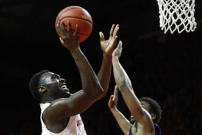 Rutgers forward Akwasi Yeboah, left, shoots over Penn State guard Izaiah Brockington during the first half of an NCAA college basketball game, Tuesday, Jan. 7, 2020, in Piscataway, N.J. (AP Photo/Michael Owens)