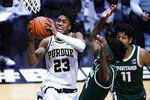Purdue guard Jaden Ivey (23) shoots in front of Michigan State forward Gabe Brown (44) during the second half of an NCAA college basketball game in West Lafayette, Ind., Tuesday, Feb. 16, 2021. (AP Photo/Michael Conroy)