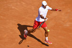 Serbia's Novak Djokovic returns the ball to Italy's Salvatore Caruso, at the Italian Open tennis tournament in Rome, Wednesday, Sept. 16, 2020. (Alfredo Falcone/LaPresse via AP)