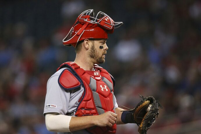 FILE - In this Sept. 25, 2019 file photo St. Louis Cardinals catcher Matt Wieters pauses behind home plate during the first inning of a baseball game against the Arizona Diamondbacks in Phoenix. The Cardinals signed Wieters to a contract for the 2020 season on Wednesday, Jan. 22, 2020 bringing back the 33-year-old veteran to fill the same role behind Yadier Molina as last season. (AP Photo/Ross D. Franklin, file)