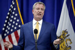FILE - In this May 1, 2018, file photo, New York City Mayor Bill de Blasio speaks during a news conference in Newark, N.J. Asian-Americans have been divided over affirmative action for decades, long before New York City's mayor proposed an admissions overhaul to admit more blacks and Latinos into elite city schools currently dominated by Asians. (AP Photo/Julio Cortez, File)