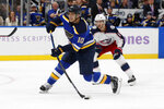 St. Louis Blues' Brayden Schenn (10) shoots for a goal as Columbus Blue Jackets' Alexander Wennberg, of Sweden, watches during the second period of an NHL hockey game Friday, Nov. 1, 2019, in St. Louis. (AP Photo/Jeff Roberson)