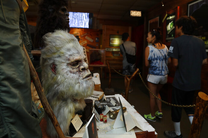 This Aug. 8, 2019, photo shows a Bigfoot mask and other items donated by the family of Yeti researcher Tom Slick on display at Expedition: Bigfoot! The Sasquatch Museum in Cherry Log, Ga. The owner of this intriguing piece of Americana at the southern edge of the Appalachians is David Bakara, a longtime member of the Bigfoot Field Researchers Organization who served in the Navy, drove long-haul trucks and tended bar before opening the museum in early 2016 with his wife, Malinda. (AP Photo/John Bazemore)