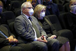Minnesota Governor Tim Walz, center and his wife, Gwen Walz attend a memorial service for George Floyd at North Central University Thursday, June 4, 2020, in Minneapolis. (AP Photo/Julio Cortez)