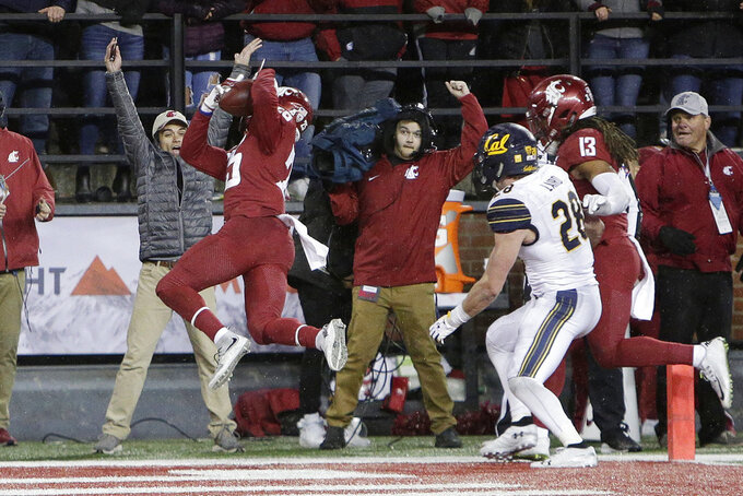 Washington State safety Skyler Thomas, left, intercepts a California pass during the second half of an NCAA college football game in Pullman, Wash., Saturday, Nov. 3, 2018. Washington State won 19-13. (AP Photo/Young Kwak)