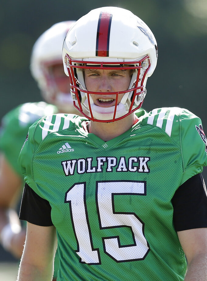 In this photo taken Thursday, Aug. 9, 2018, North Carolina State quarterback Ryan Finley takes the field during an NCAA college football practice in Raleigh, N.C. (AP Photo/Gerry Broome)