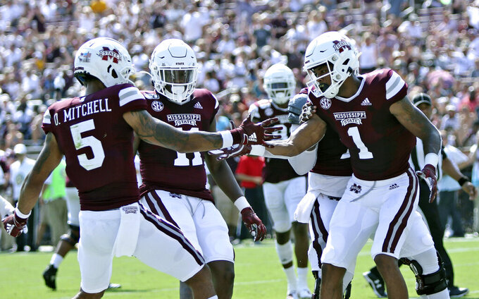Mississippi State wide receiver Osirus Mitchell (5) congratulates wide receiver Stephen Guidry (1) on a first half touchdown catch against Southern Mississippi during their NCAA college football game Saturday, Sept. 7, 2019, in Starkville, Miss. (AP Photo/Jim Lytle)