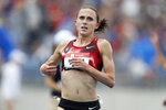 FILE - In this Sunday, July 28, 2019, file photo, Shelby Houlihan crosses the finish line as she wins the women's 5,000-meter run at the U.S. Championships athletics meet, in Des Moines, Iowa. Banned runner Shelby Houlihan is in the lineup and will be allowed to run at U.S. Olympic track trials while any appeals she files are pending. The American record holder at 1,500 and 5,000 meters, Houlihan is on the start list for Friday's, June 18, 2021, 5,000 preliminaries.  (AP Photo/Charlie Neibergall, File)