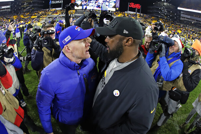 Pittsburgh Steelers head coach Mike Tomlin, right, and Buffalo Bills head coach Sean McDermott visit following an NFL football game in Pittsburgh, Sunday, Dec. 15, 2019. The Bills won 17-10. (AP Photo/Gene J. Puskar)