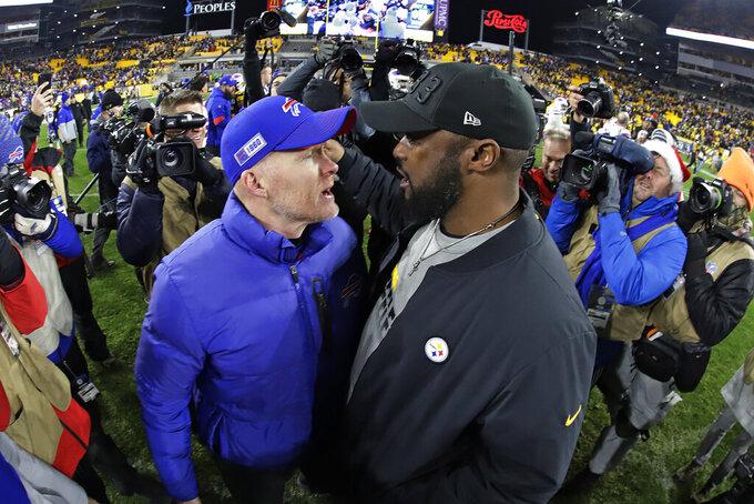 Pittsburgh Steelers head coach Mike Tomlin, right, and Buffalo Bills head coach Sean McDermott visit following an NFL football game in Pittsburgh, Sunday, Dec. 15, 2019. The Bills won 17-10. (AP Photo/Gene J. Puskar)