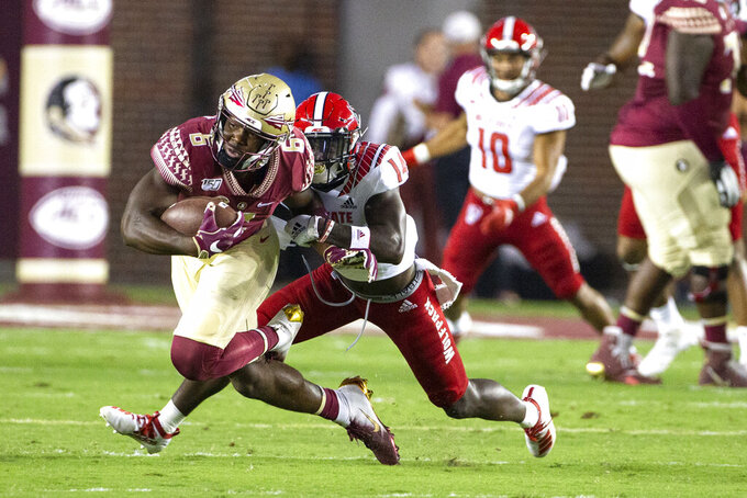 Florida State tight end Tre' McKitty (6) is brought down by North Carolina State safety De'Von Graves (14) in the first half of an NCAA college football game in Tallahassee, Fla., Saturday, Sept. 28, 2019. (AP Photo/Mark Wallheiser)