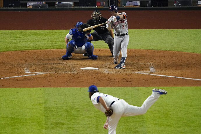 Houston Astros' Alex Bregman hits a double off Texas Rangers starting pitcher Lance Lynn during the sixth inning of a baseball game in Arlington, Texas, Thursday, Sept. 24, 2020. (AP Photo/Tony Gutierrez)