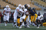 Stanford running back Nathaniel Peat (8) rushes against California during the second half of an NCAA college football game Friday, Nov. 27, 2020, in Berkeley, Calif. (AP Photo/Jed Jacobsohn)