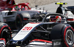 Haas driver Kevin Magnussen of Denmark steers his car followed by Alfa Romeo driver Antonio Giovinazzi of Italy during the qualifying session at the Red Bull Ring racetrack in Spielberg, Austria, Saturday, July 4, 2020. The Austrian Formula One Grand Prix will be held on Sunday. (AP Photo/Darko Bandic)