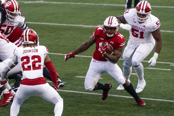 Wisconsin's Nakia Watson runs during the first half of an NCAA college football game against Indiana Saturday, Dec. 5, 2020, in Madison, Wis. (AP Photo/Morry Gash)