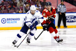 Tampa Bay Lightning center Tyler Johnson (9) skates with the puck as Florida Panthers center Noel Acciari (55) defends during the second period in Game 2 of an NHL hockey Stanley Cup first-round playoff series Tuesday, May 18, 2021, in Sunrise, Fla. (AP Photo/Lynne Sladky)
