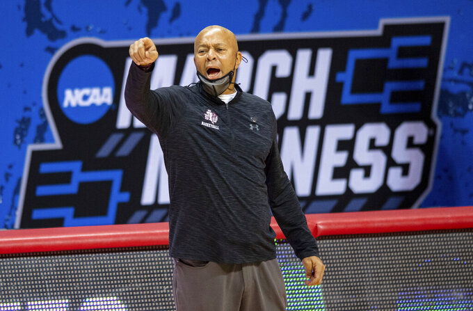 Texas Southern coach Johnny Jones reacts during the second half of the team's First Four game against Mount St. Mary's in the NCAA men's college basketball tournament, Thursday, March 18, 2021, in Bloomington, Ind. (AP Photo/Doug McSchooler)