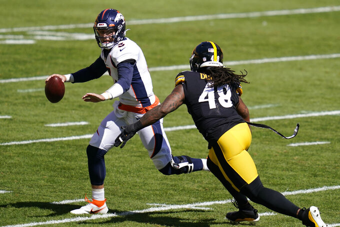 Denver Broncos quarterback Drew Lock (3) looks to pass under pressure by Pittsburgh Steelers outside linebacker Bud Dupree (48) during the first half of an NFL football game, Sunday, Sept. 20, 2020, in Pittsburgh. (AP Photo/Keith Srakocic)