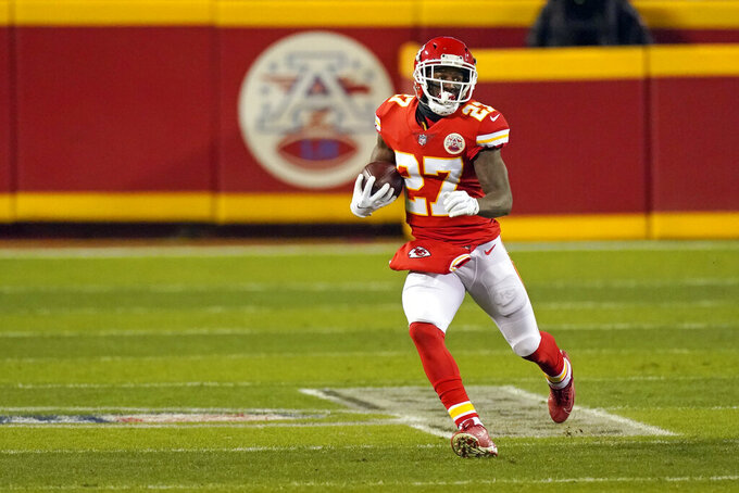 Kansas City Chiefs cornerback Rashad Fenton runs up field after intercepting a pass during the second half of the AFC championship NFL football game against the Buffalo Bills, Sunday, Jan. 24, 2021, in Kansas City, Mo. (AP Photo/Charlie Riedel)