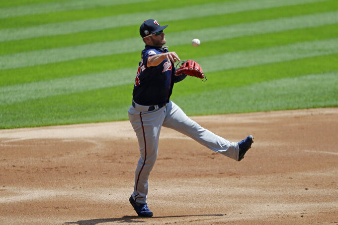 Minnesota Twins third baseman Josh Donaldson throws out Chicago White Sox's Tim Anderson at first during the first inning of a baseball game in Chicago, Saturday, July 25, 2020. (AP Photo/Nam Y. Huh)