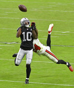 Las Vegas Raiders wide receiver Rico Gafford (10) misses a catch while guarded by Tampa Bay Buccaneers cornerback Carlton Davis (24) during the second half of an NFL football game, Sunday, Oct. 25, 2020, in Las Vegas. (AP Photo/David Becker)