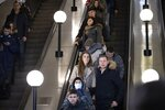 In this photo taken on Saturday, Feb. 22, 2020, people go down on the escalator in a Moscow's Metro (subway) station in Moscow, Russia. Metro workers were instructed to stop passengers from China and ask them to fill out a questionnaire about the purpose of their visit to Russia, address of residence, health condition and whether they underwent quarantine upon arrival. (AP Photo/Alexander Zemlianichenko)