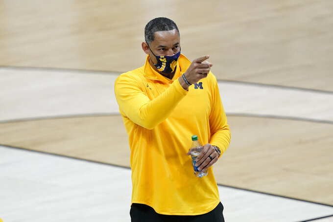 Michigan head coach Juwan Howard reacts after a second-round game against LSU in the NCAA men's college basketball tournament at Lucas Oil Stadium Monday, March 22, 2021, in Indianapolis. Michigan won 86-78. (AP Photo/AJ Mast)