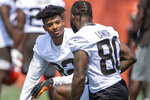 Cleveland Browns receiver Rashard Higgins, left, talks with receiver Jarvis Landry in-between reps during NFL football practice in Berea, Ohio, Wednesday, July 28, 2021. (AP Photo/David Dermer)