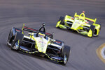 Sebastian Bourdais (18) leads Simon Pagenaud on the 15th lap during the IndyCar auto race Saturday, April 7, 2018, at Phoenix International Raceway in Avondale, Ariz. (AP Photo/Rick Scuteri)