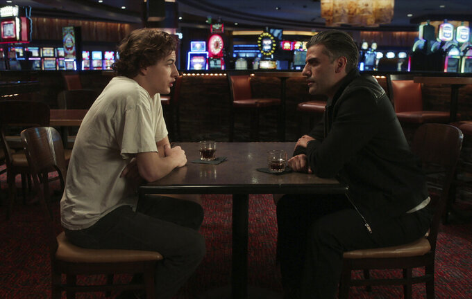 """This image released by Focus Features shows Tye Sheridan, left, and Oscar Isaac in a scene from """"The Card Counter."""" (Focus Features via AP)"""