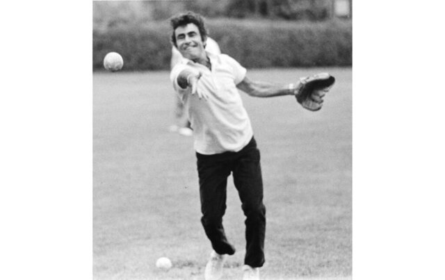 This 1973 family photo provided by Anne Serling shows her father, television writer Rod Serling tossing a softball at a school his daughter attended, in Massachusetts. Years before he journeyed to