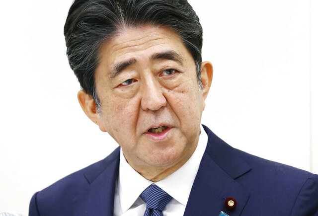 Former Japanese Prime Minister Shinzo Abe speaks during a press conference in Tokyo, Thursday, Dec. 24, 2020. Abe offered his deep apologizes on Thursday over illegal expenses linked to a dinner party his office hosted for his supporters ahead of an annual cherry blossom viewing party.(Kyodo News via AP)