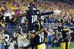 Pittsburgh Steelers wide receiver Diontae Johnson (18) celebrates with JuJu Smith-Schuster (19) after scoring on a pass from quarterback Mason Rudolph during the second half of an NFL football game against the Cincinnati Bengals in Pittsburgh, Monday, Sept. 30, 2019. (AP Photo/Tom E. Puskar)