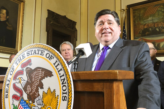 Illinois Gov. J.B. Pritzker smiles as he explains legislation he's backing to make it easier for taxpayers to locate information about lobbyists, their clients, and campaign contributions, in his Statehouse office, Thursday, Nov. 14, 2019. The bill will also create an ethics commission to recommend other ethics measures after a federal bribery complaint against former Rep. Luis Arroyo, D-Chicago. (AP Photo/John O'Connor)
