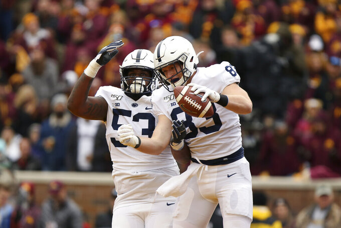 Penn State tight end Nick Bowers (83) celebrates with teammate offensive lineman Rasheed Walker (53) after Bowers scored a touchdown during an NCAA college football game against Minnesota, Saturday, Nov. 9, 2019, in Minneapolis. Minnesota won 31-26. (AP Photo/Stacy Bengs)
