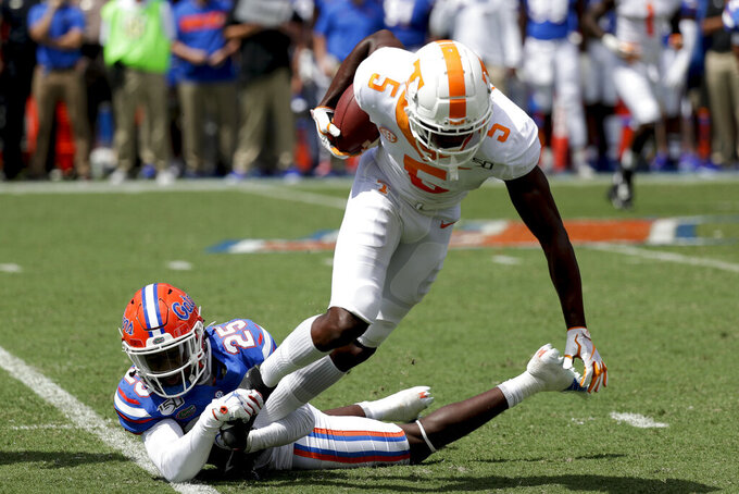 Florida defensive back Chester Kimbrough (25) stops Tennessee wide receiver Josh Palmer (5) after a reception during the first half of an NCAA college football game, Saturday, Sept. 21, 2019, in Gainesville, Fla. (AP Photo/John Raoux)