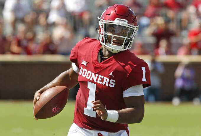 FILE - In this Sept. 1, 2018, file photo, Oklahoma quarterback Kyler Murray (1) carries the ball in the first half of an NCAA college football game against Florida Atlantic, in Norman, Okla. Murray was named a Heisman Trophy finalist on Monday, Dec. 3, 2018. (AP Photo/Sue Ogrocki, File)