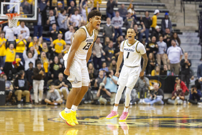 Missouri's Mark Smith, left, and Xavier Pinson, right, celebrate Smith's three point shot late during the second half of an NCAA college basketball game against Texas A&M Tuesday, Jan. 21, 2020, in Columbia, Mo. Texas A&M won the game 66-64. (AP Photo/L.G. Patterson)