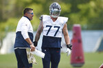 Tennessee Titans head coach Mike Vrabel talks with offensive tackle Taylor Lewan (77) during NFL football training camp Tuesday, Aug. 25, 2020, in Nashville, Tenn. (George Walker IV/The Tennessean via AP, Pool)