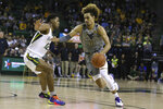 West Virginia forward Emmitt Matthews Jr., right, drives around Baylor guard Jared Butler, left, in the first half of an NCAA college basketball game, Saturday, Feb. 15, 2020, in Waco, Texas. (AP Photo/Rod Aydelotte)