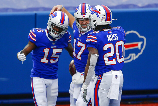 Buffalo Bills wide receiver John Brown (15) celebrates after catching a touchdown pass thrown by quarterback Josh Allen (17) in the first half of an NFL football game against the Miami Dolphins, Sunday, Jan. 3, 2021, in Orchard Park, N.Y. (AP Photo/John Munson)