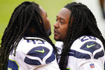 Seattle Seahawks outside linebacker Shaquem Griffin (49) and teammate cornerback Shaquill Griffin (26) greeting each other before the start of the first half of an NFL football game against the Washington Football Team, Sunday, Dec. 20, 2020, in Landover, Md. (AP Photo/Andrew Harnik)
