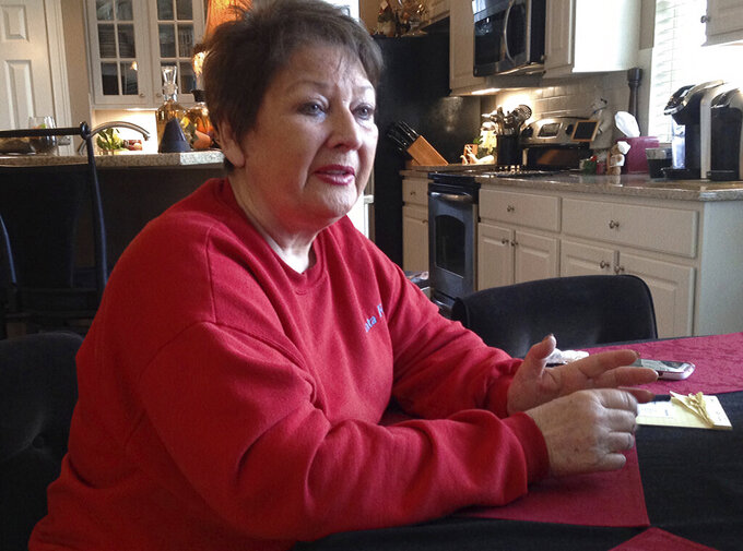 This Dec. 15, 2015 file photo shows Anita Barney talking about losing her fortune in a swindle perpetrated by former Ohio State quarterback Art Schlichter, followed by her own role stealing nearly $500,000 from friends on Schlichter's instructions, in Dublin, Ohio. (AP Photo/Andrew Welsh-Huggins, File)