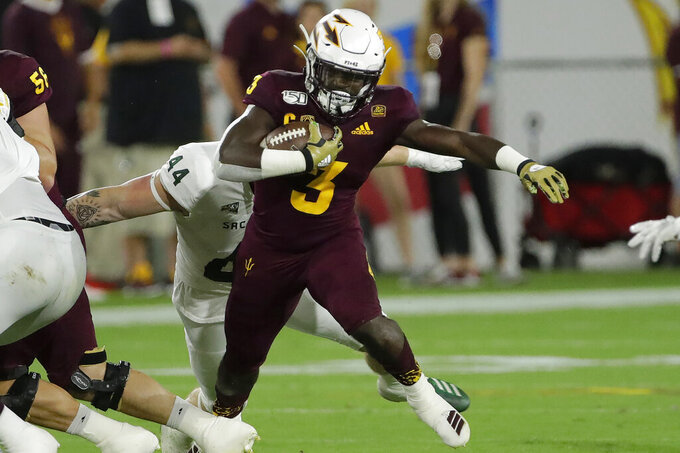 Arizona State running back Eno Benjamin (3) is chased down by Sacramento State defensive lineman Josiah Erickson (44) during the first half of an NCAA college football game Friday, Sept. 6, 2019, in Tempe, Ariz. (AP Photo/Matt York)